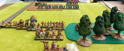 The Carthaginian deployment is cramped by a large wood.